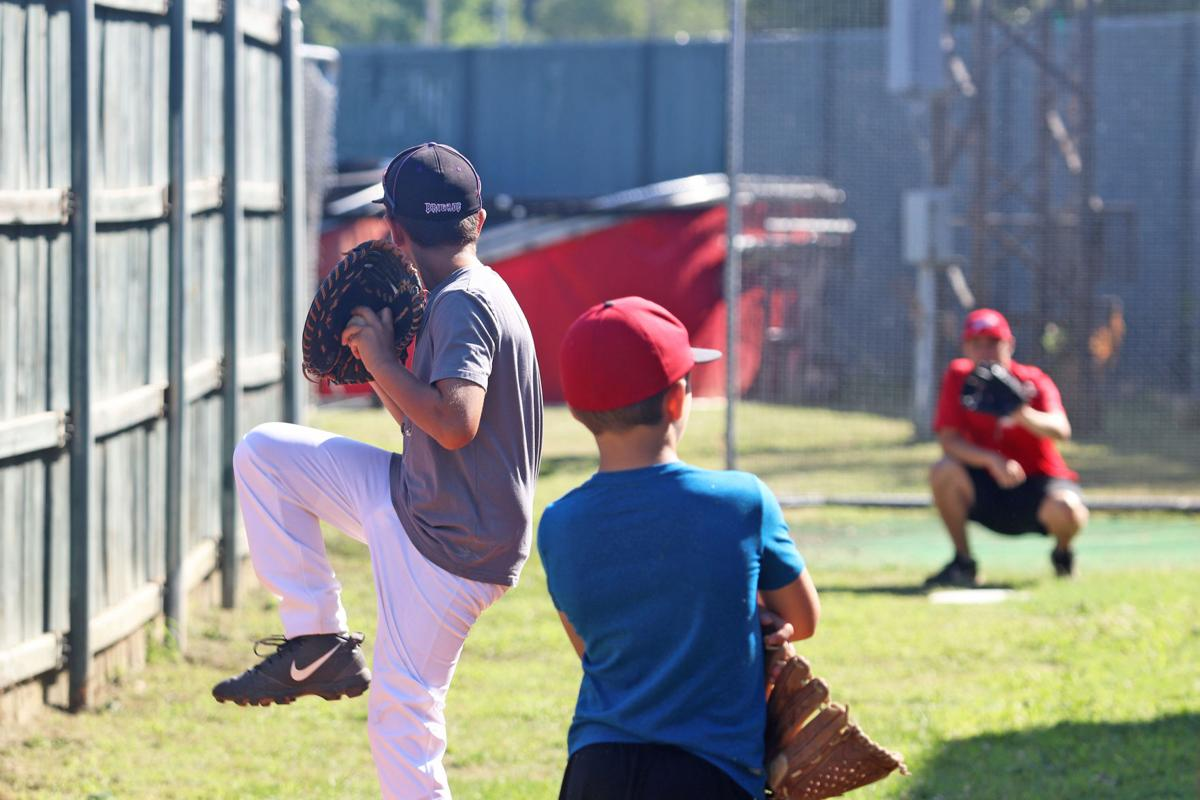 Baseball camp practices pitching