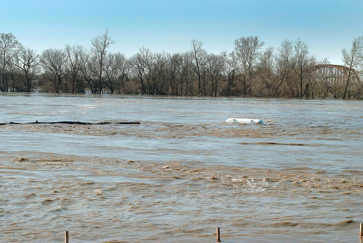 Debris bobbing down the Missouri River