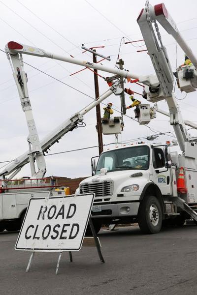 KCP&L crews repair a utility pole