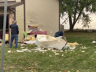 Car crashes into two homes Thursday morning