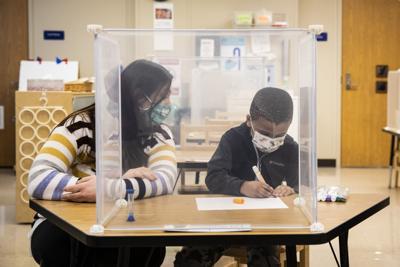 Virus Outbreak Chicago Schools