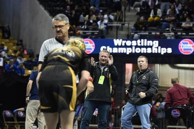 Lathrop coach Rick Mudd celebrates victory