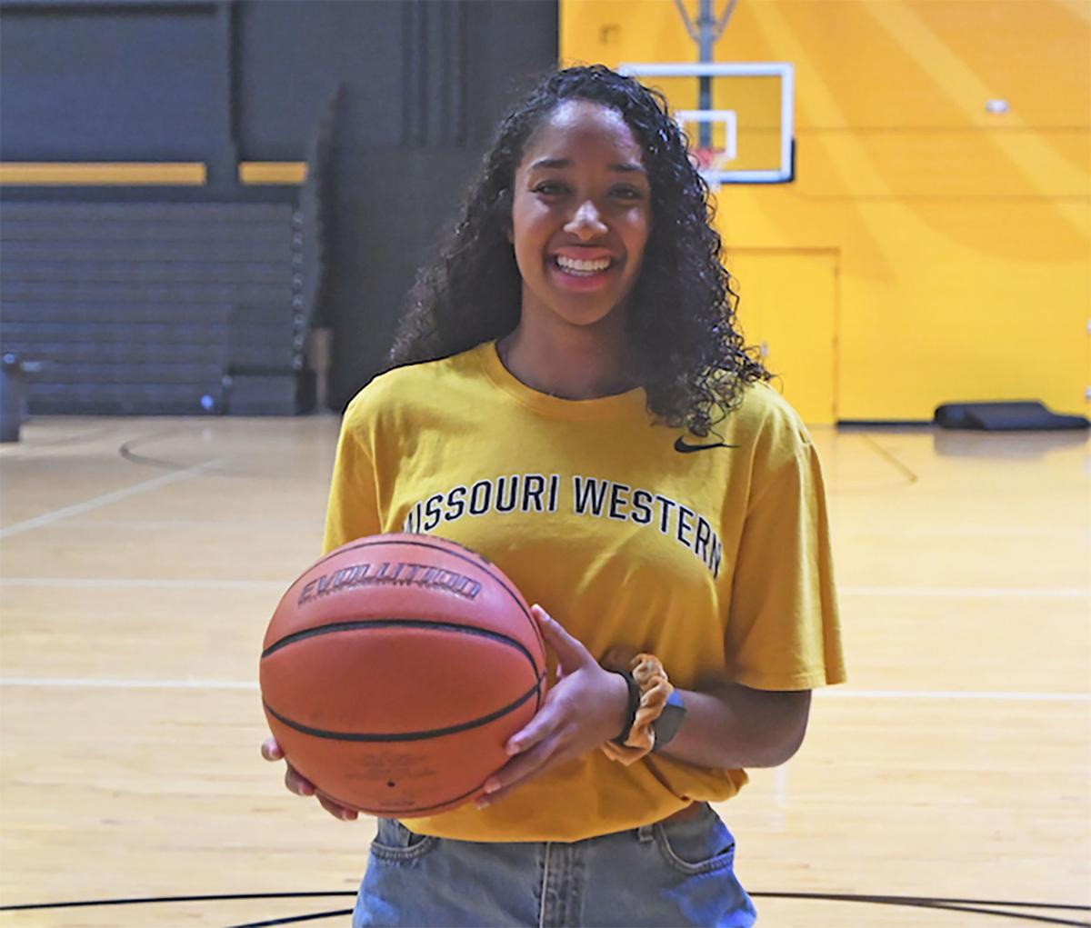 Simone Rodney poses with basketball
