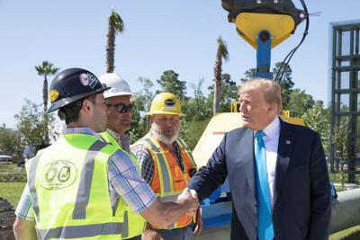 Trump handshake photo