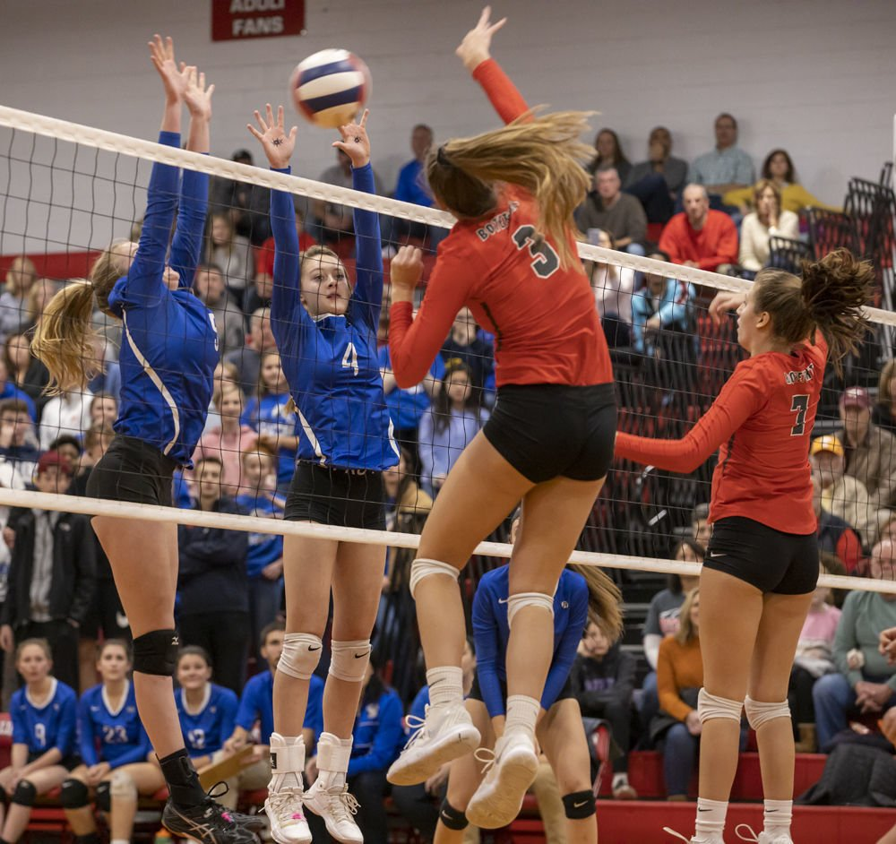 Lord Botetourt's (3) Miette Veldman tries to spike the ball past  Fort Defiance's (5) Madison Painter and (4) Leilani Goggin. Lord Botetourt's (7) Parker Hudson looks on.