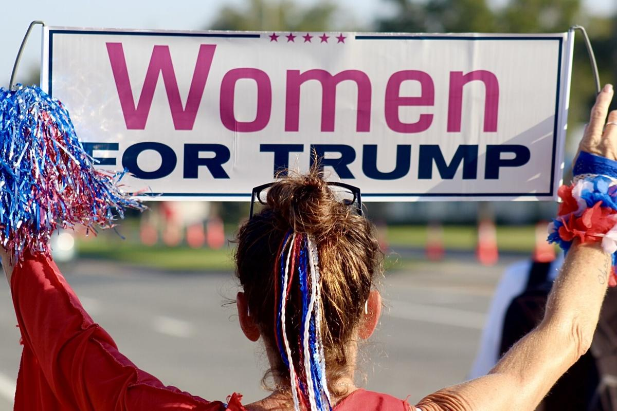 {INSERT ALL IMAGES 6 OF 8: GROUPS OF PEOPLE WITH SIGNS women for trump}