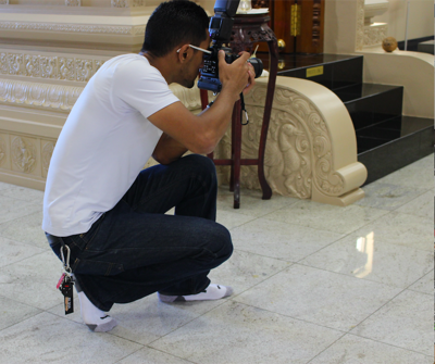 Student photographer featured in art gallery showcasing Indian culture and religion