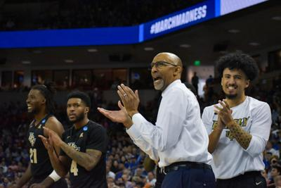 UCF head coach Johnny Dawkins cheering with his players