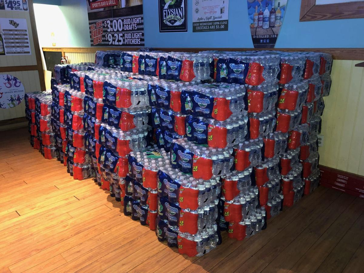 Local UCF bar gives out free cases of water bottles for Hurricane Dorian