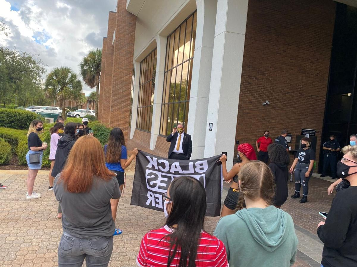 UCF student activists demand action after altercation with gun-rights activist Kaitlin Bennett