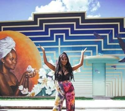 A UCF Alumni helps create a mural in the heart of Orlando