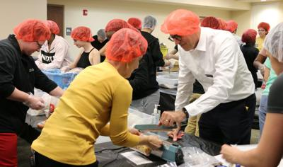 Student volunteers packed thousands of meals for the Knights Pantry