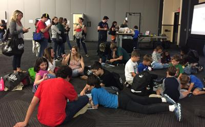 Hundreds of kids try out drones at GIS Day event (THIS ONE)