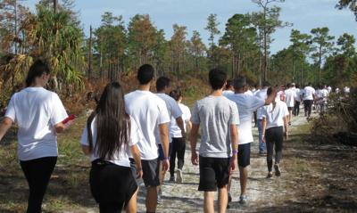 Senior holds biggest UCF 6K WASH Project ever at the Arborteum MA