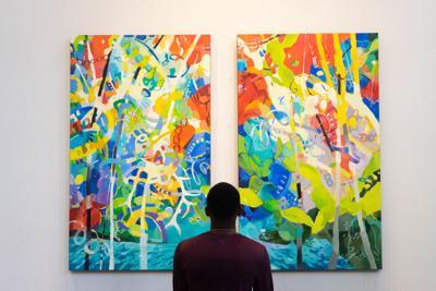 Museum-goer admires painting
