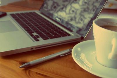 laptop side view with coffee