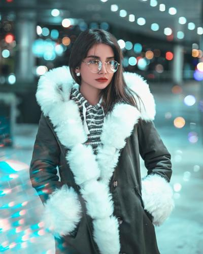 posed woman in fluffy coat