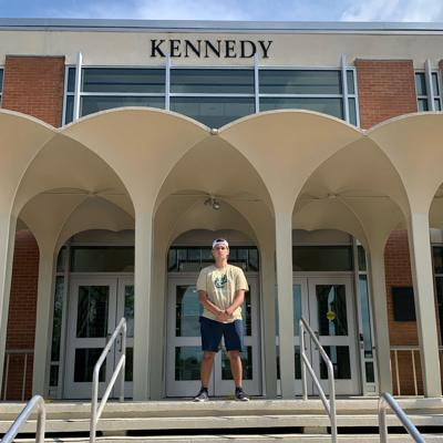 Drew Pescaro in front of Kennedy