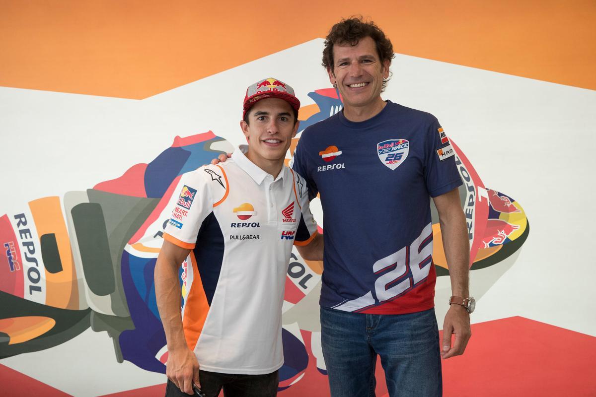 Juan Velarde and Marc Marquez pose for a portrait at MotoGP World Championship
