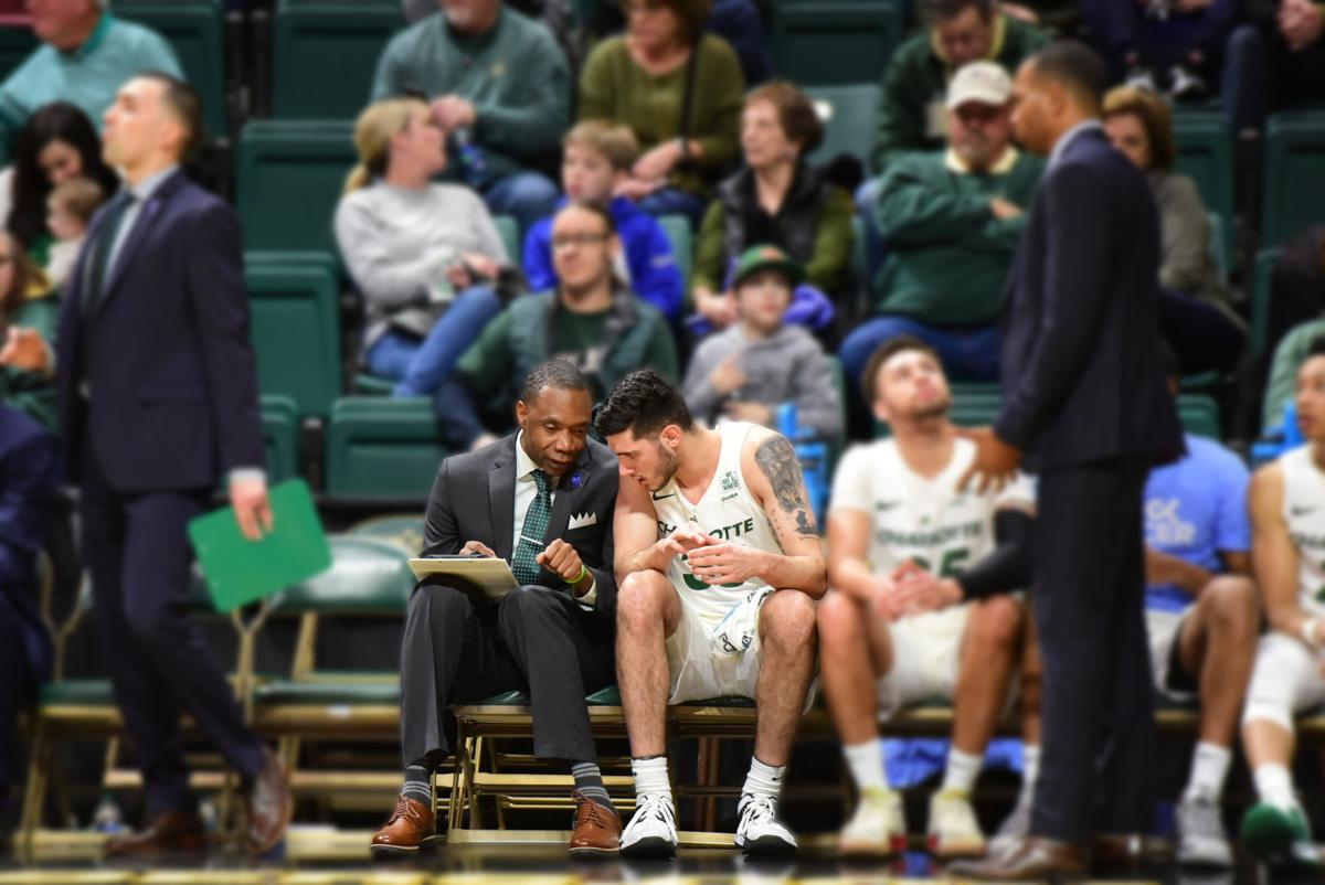 Byron Dinkins talks with Luka Vasic on the bench