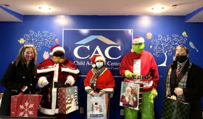 CAC and special guests deliver gifts to children and families