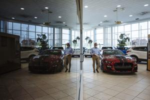 Buyers snap up new cars as U.S. auto sales surge.