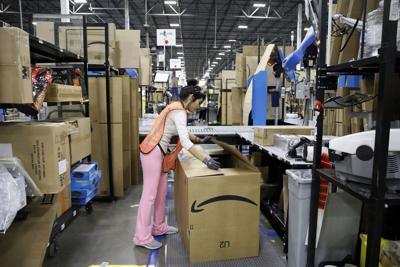 Amazon again posts record sales, profit amid COVID