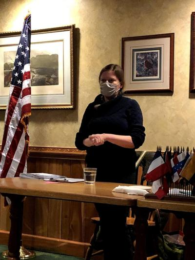Librarian chats with Kiwanis