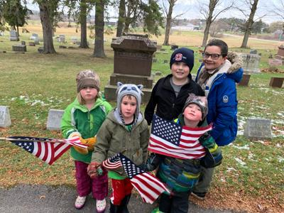 Cub Scout Pack collects flags from Hermon Cemetery