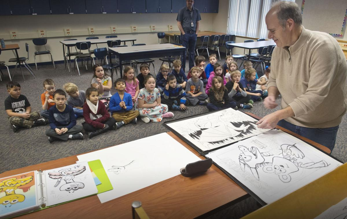 Illustrator draws in St. Lawrence students