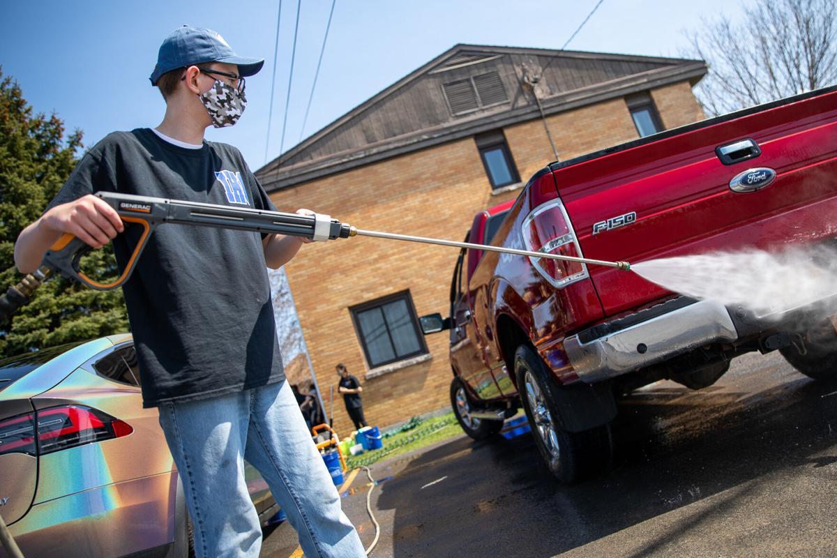 IHC car wash helps 'adopted' Tanzania school