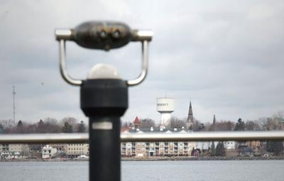 CHRISTOPHER LENNEY n WATERTOWN DAILY TIMES- A pair of binoculars in Ogdensburg's Greenbelt Park looks out on the Prescott, Ontario waterfront. (Robinson)