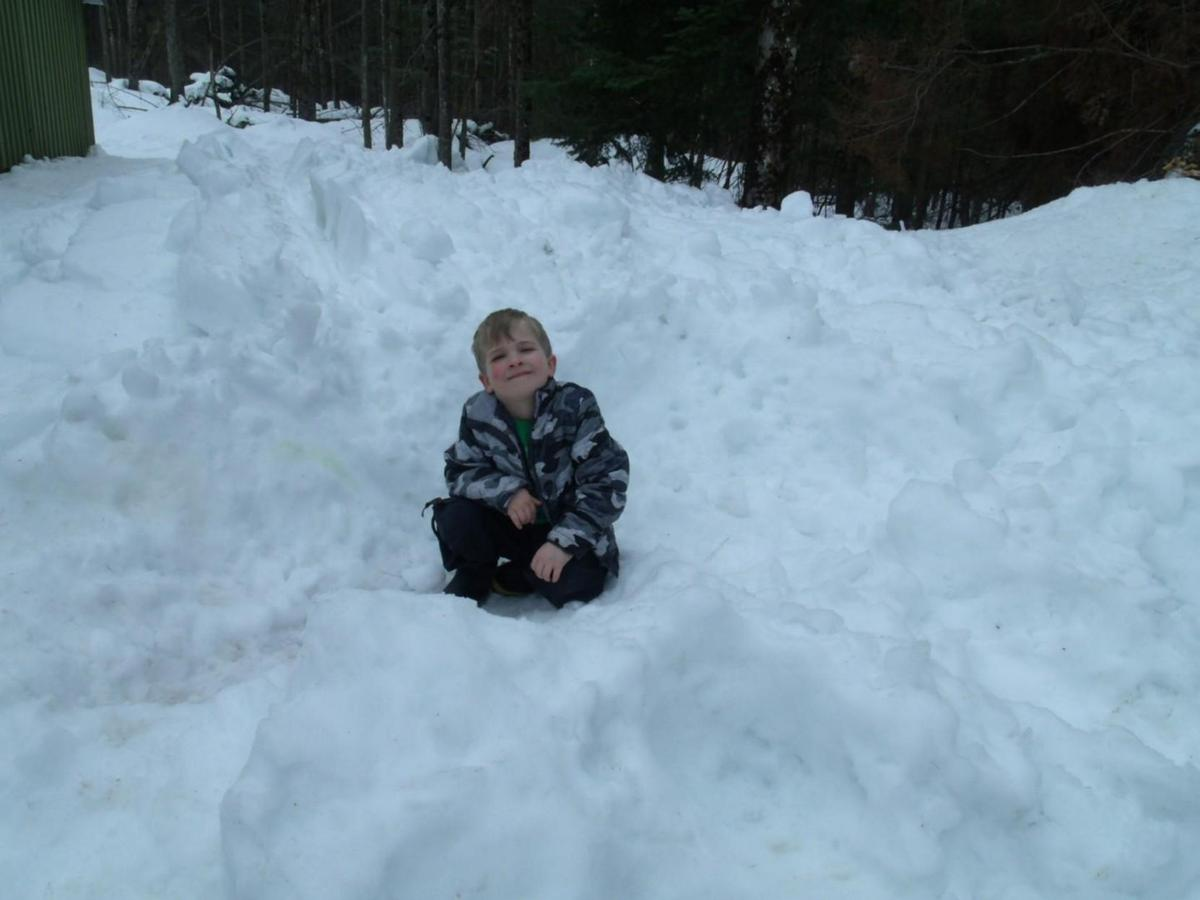 Neighbors join to save boy in snow