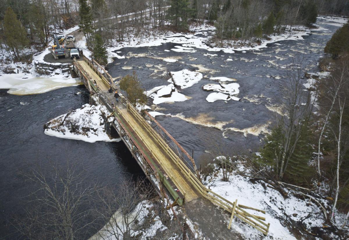 Replacement bridges span St. Regis River