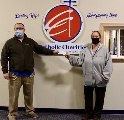 Fulton Lions Club donates $1,000 to Catholic Charities