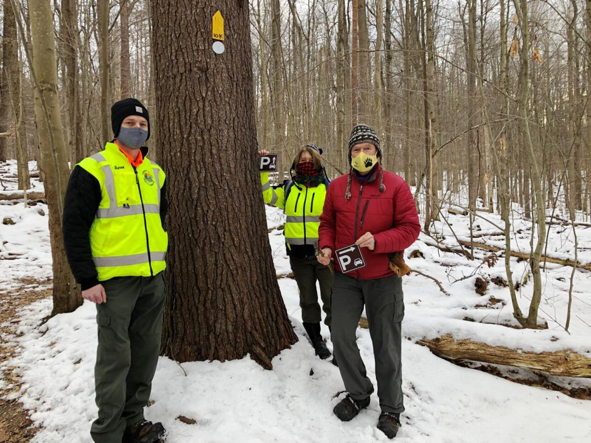 Oswego County Search and Rescue teams up with Friends of Great Bear to install new signs on popular trail system