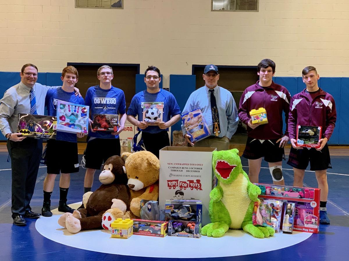 Oswego High School varsity wrestling team gives back