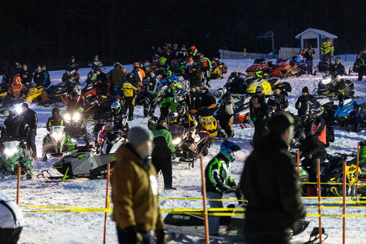 Snowmobile races heat up the night