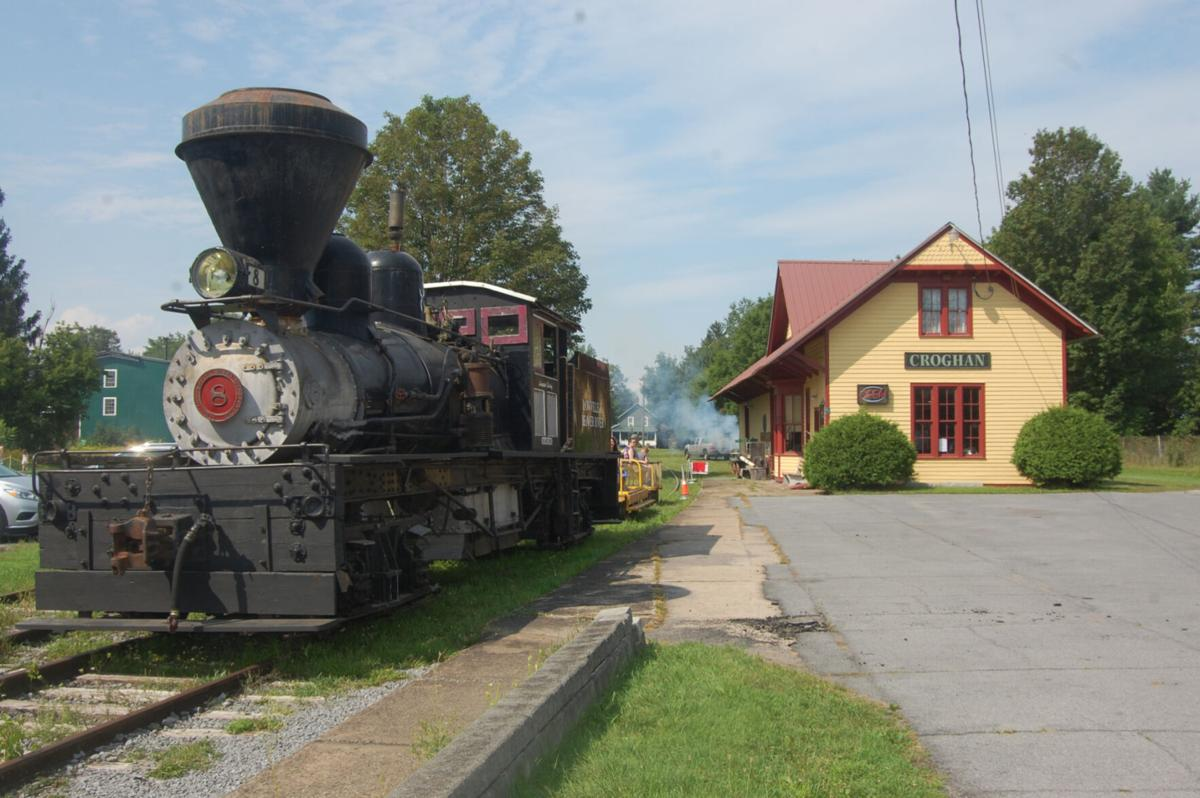 Visitors ride rails in 1945 speeder car for Croghan's annual Iron Horse Day