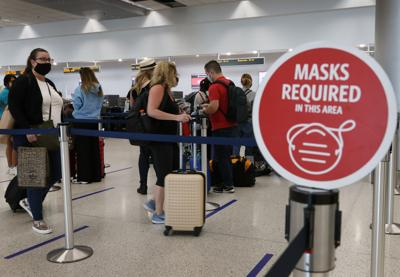 CDC says vaccinated people can travel, should wear masks