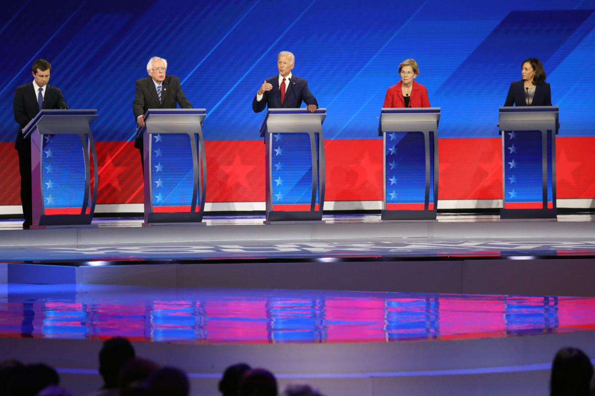 Divide over health care ignites fiery exchanges in Democratic debate