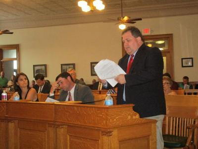 Tempers flare as legislators try to set public hearing date