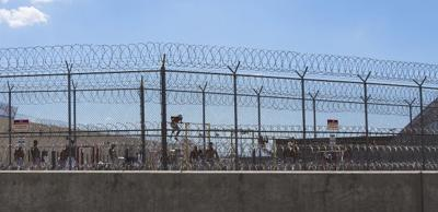 Why was American detained?