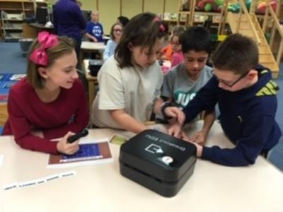 Minetto fourth graders use life skills to complete Halloween teamwork activity