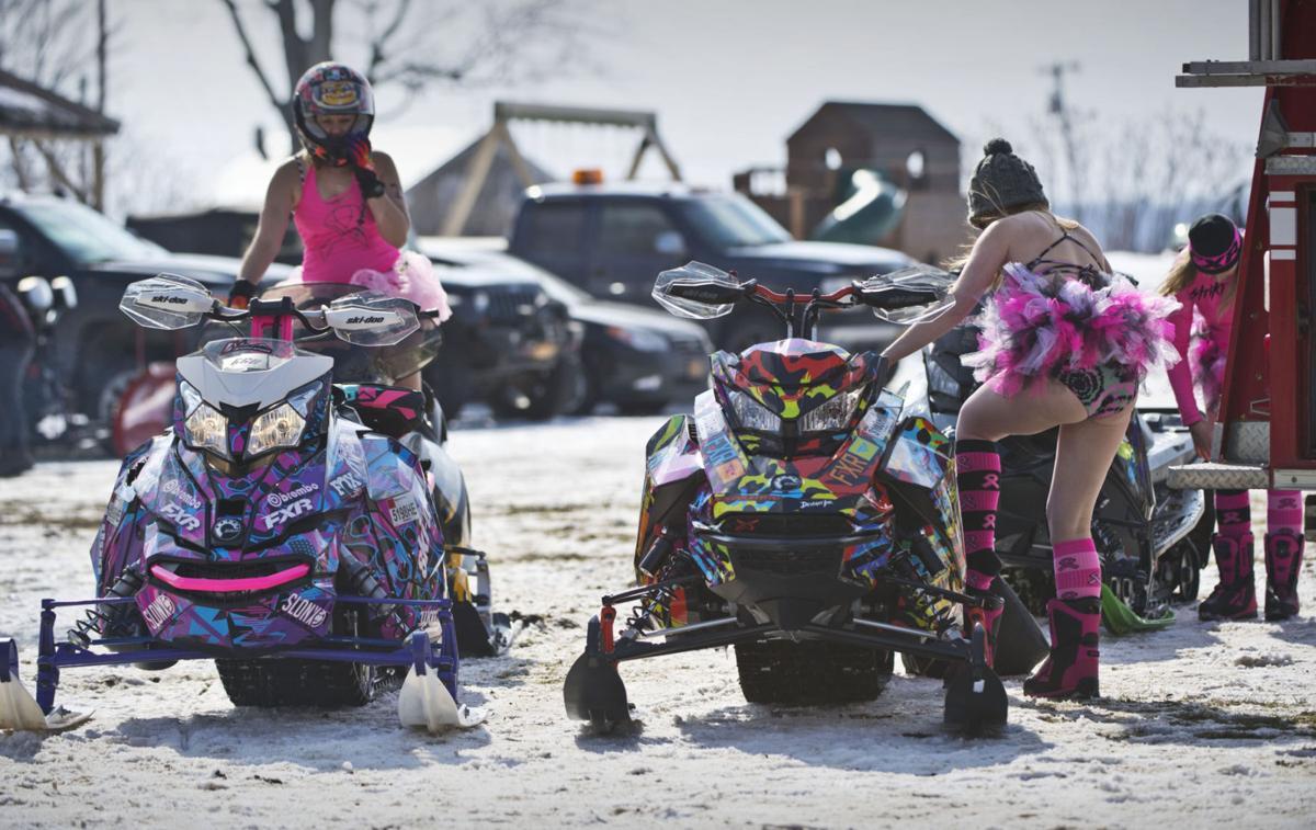 Bikini-clad snowmobilers rally again to fight breast cancer
