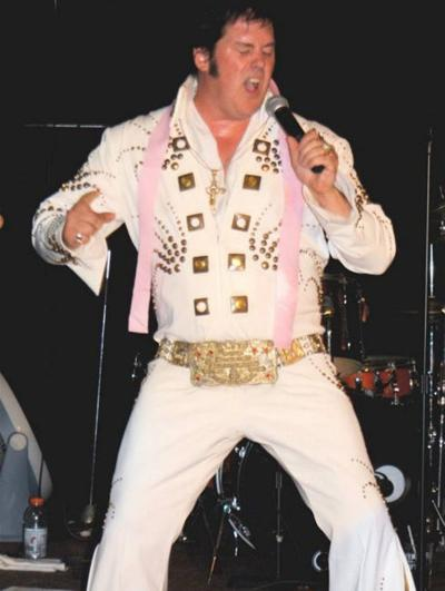 Tom Gilbo, Elvis impersonator, performs in Central Square
