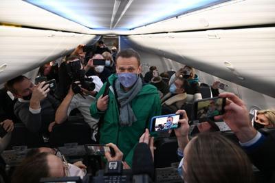 Jailed Kremlin foe says he has cough, fever amid hunger strike