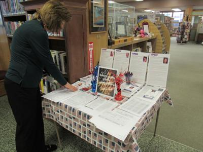 Massena has voter info at library table