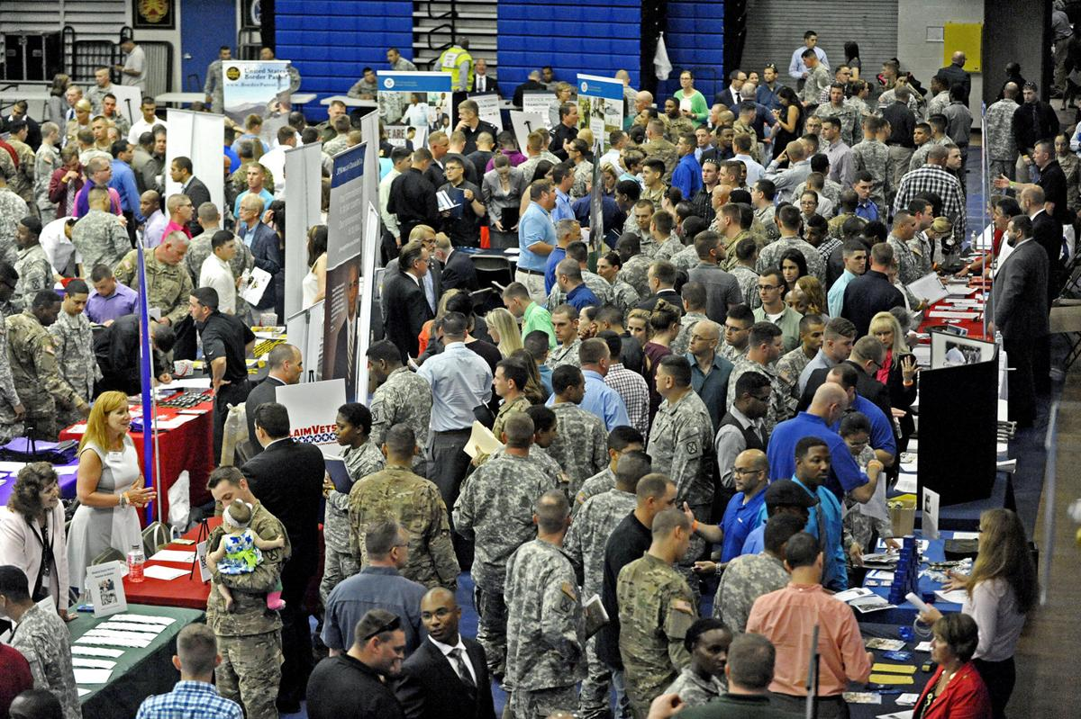 Soldiers, spouses consider next steps at job fair FORT DRUM