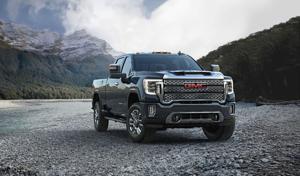 GM reports third-quarter sales decline, slips to third in truck war.